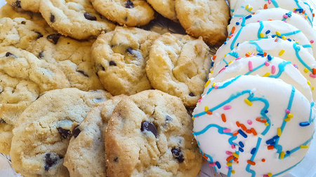 closeup of chocolate chip cookies and sugar cookies Stock Photo