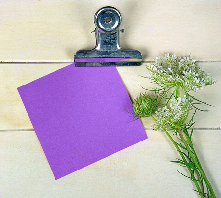 bold purple note paper on clipboard with Queen Annes Lace bouquet