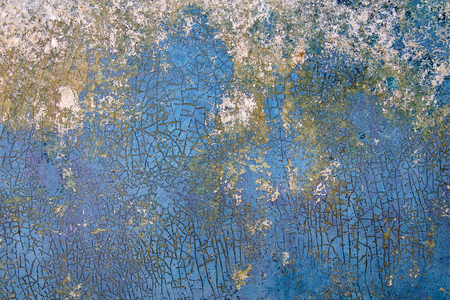 close up of cracked and chipped blue paint on metal surface Stock Photo