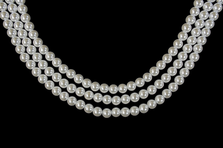 three strand pearl necklace on black background Stock Photo
