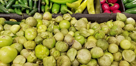 fresh green sprouts with variety of peppers at the food market