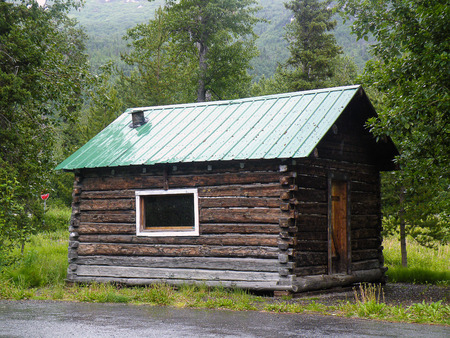 old rustic log cabin in Alaska wilderness Stock Photo