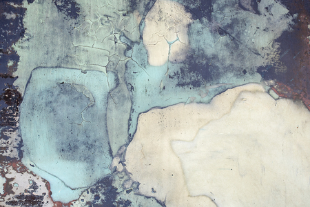 close up of faded and dirty blue paint abstract pattern