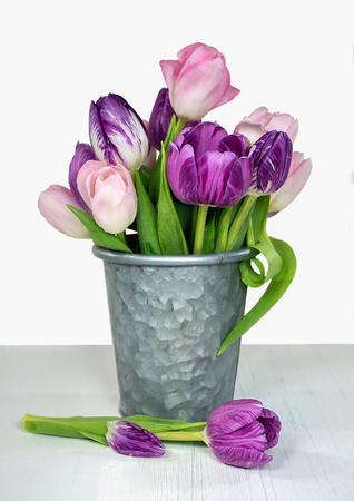 pink and purple tulip bunch in metal gray bucket