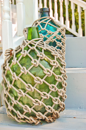 rope macrame on glass bottles on wooden stairs