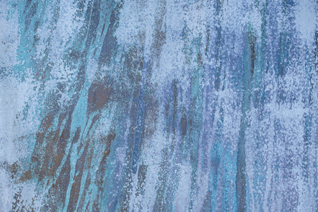 close up of faded abstract blue textured paint streak pattern