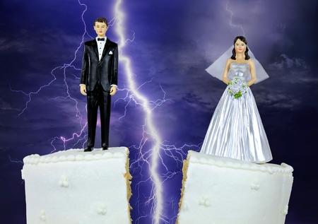 bride and groom figurine on split wedding cake with storm lightning background Stock Photo