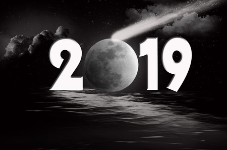 comet and moon reflection on black water for New Year 2019