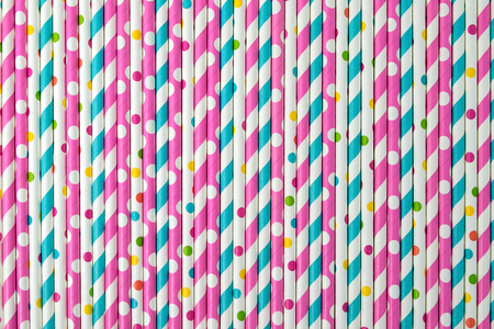 row of colorful drinking straws background