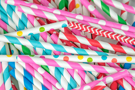 close up of a pile of colorful drinking straws