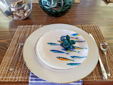 fish design on plate with flower place setting