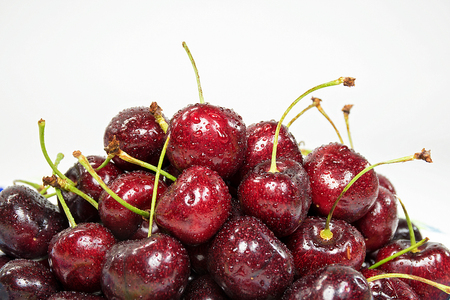 close up of red cherry pile with water droplets Stock Photo
