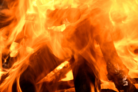 extreme close up of fire and logs in campfire Stock Photo
