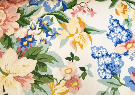 close up of colorful retro floral fabric pattern with yellow iris and blue flowers