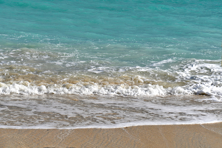Bahamas turquoise ocean water color and sandy beach