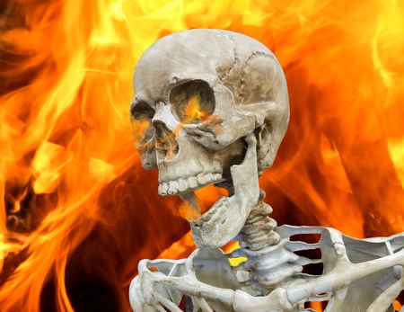 close up of skeleton with fire background