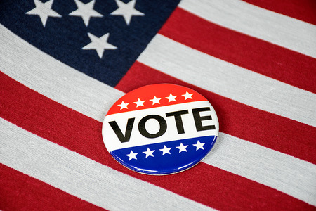 close up of campaign button on American flag