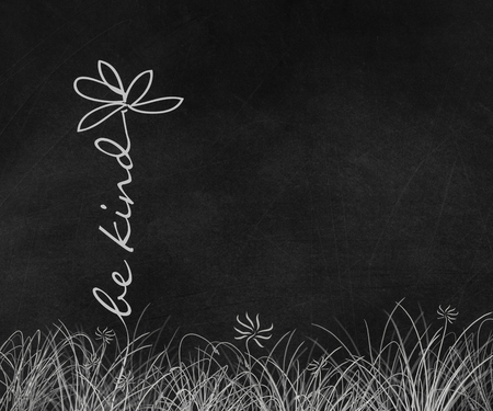 be kind text white daisy flower graphic in grass on old black chalkboard