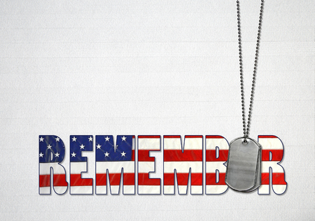 word remember with flag design and military dog tags on gray wood background