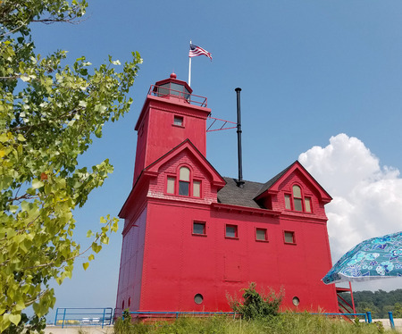 Big Red lighthouse on sand dune in Holland Harbor in Holland Michigan