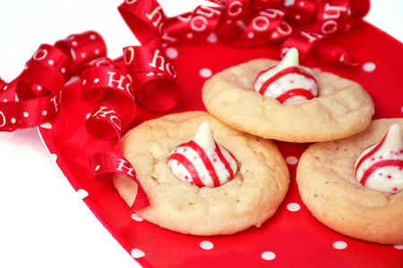 Christmas sugar cookies on red and white polka dot plate