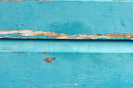 close up of weathered turquoise painted wood background Stock Photo