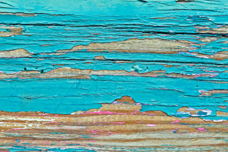 close up or peeling pink and turquoise paint on weathered wood Stock Photo
