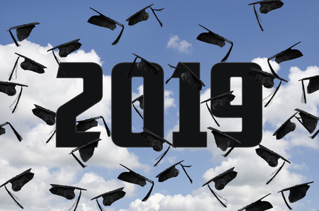 black graduation caps in summer sky with white clouds with year 2019 text