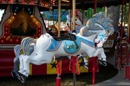 white carousel horse on merry go round