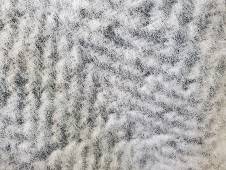 extreme close up of silver gray mohair zig zag knit pattern Banco de Imagens