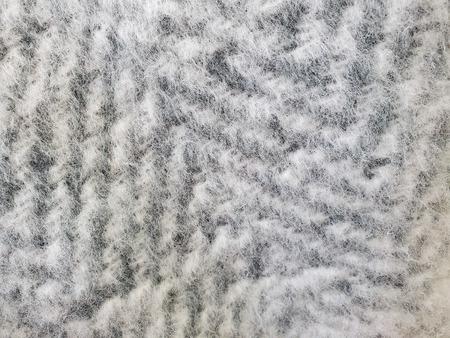 extreme close up of silver gray mohair zig zag knit pattern Reklamní fotografie