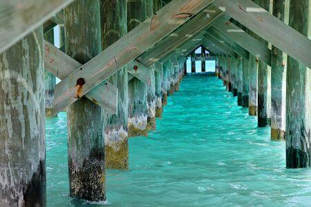 underside view of pier in Nassau Bahamas with turquoise ocean water