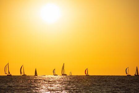 sailing regatta on Lake Michigan with sunset glow Imagens