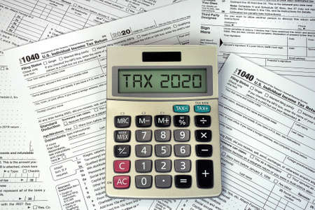 A calculator on 1040 income tax forms for 2020