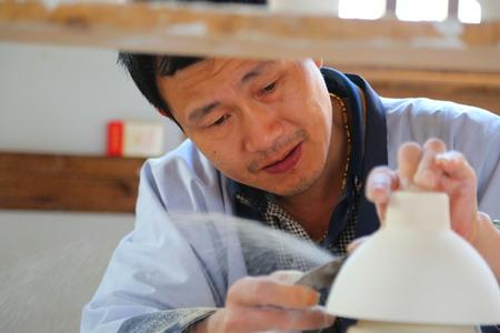 master: master making ceramic at Jingdezhen