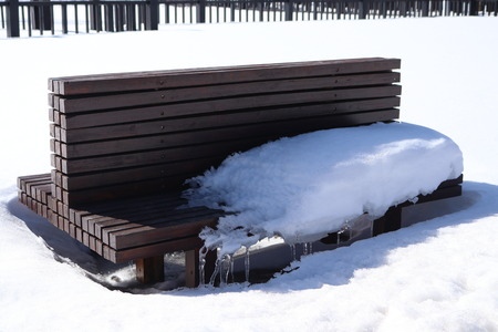 Arxan Forest Park leisure chair ice and snow occupy the seat Banco de Imagens