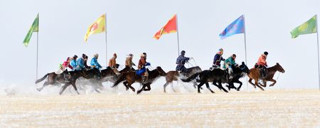 Mongolian people riding on horses 스톡 콘텐츠