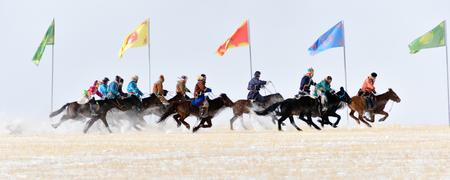 Mongolian people riding on horses Banco de Imagens