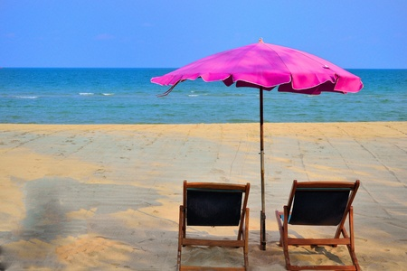 pink beach um brella Stock Photo