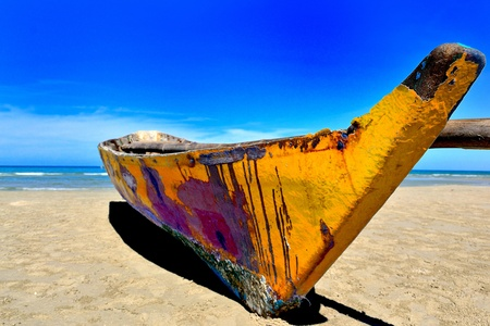 painting boat onthe beach