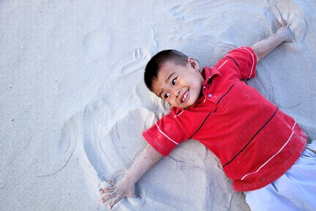 the boy relax on the beach photo