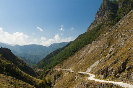apennines: ancient road in the valley below a cliff