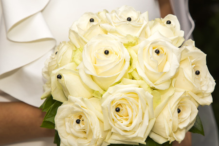 Close-up view of a bridal bouquet made of roses pale yellow photo