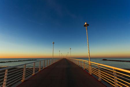blu sky: the jetty of Marina di Massa to dawn of the new year