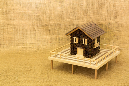 expressed: House made of coffee on burlap background Stock Photo