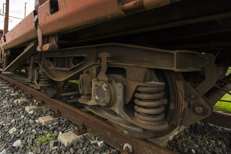 freight train: Closeup view diagonally of the wheels of a freight train Stock Photo