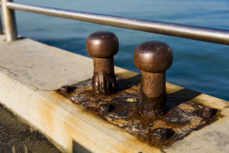 mooring bollards: Close up view of two old cleats by salt