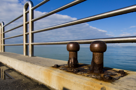 mooring bollards: View of two old cleats of a pier marine eroded by salt Stock Photo