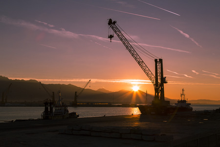 shipload: View of a crane at the port to dawn Stock Photo