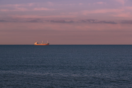 merchant: Seascape with a merchant ship in the background Stock Photo